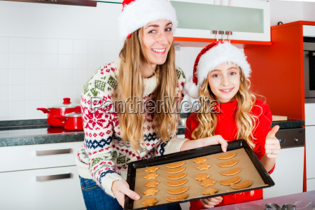 family baking biscuits in the kitchen