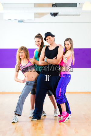 man posing with women in dance