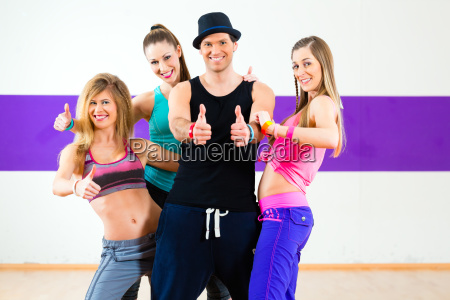 man in poses with women in