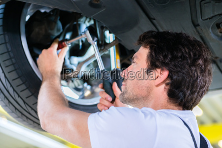 car mechanic working in auto repair