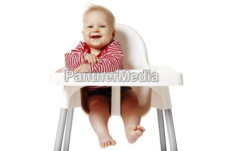 baby sitting on chair