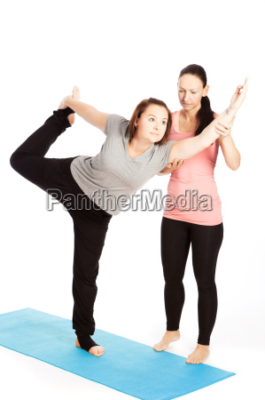 yoga teacher offers assistance in training