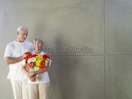 mature man with hands on womans