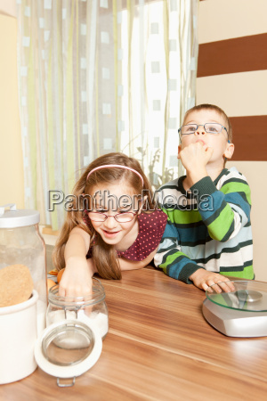 children in the kitchen while baking