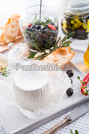 soft cheese with spicy olives