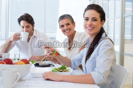 workers eat lunch and drink coffee