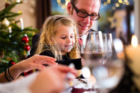 family celebrating christmas while eating