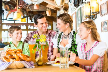 bavarian family at restaurant