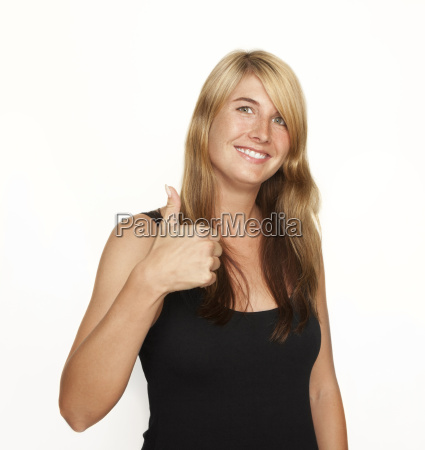 smiling woman thumbs up