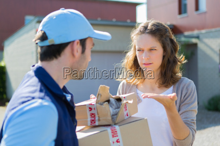 young attractive woman angry against delivery