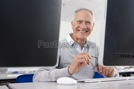smiling adult student studying in college