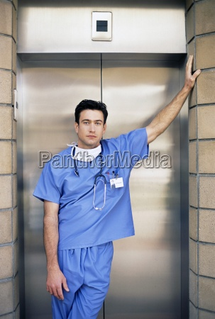 portrait of serious doctor leaning on