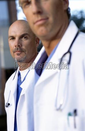 close up portrait of serious doctors