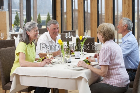 happy couples dining at restaurant table