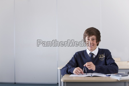 portrait of smiling male student in