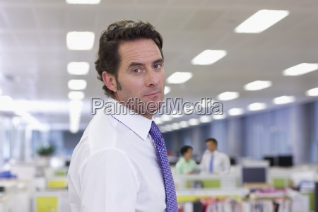 portrait of serious businessman in office