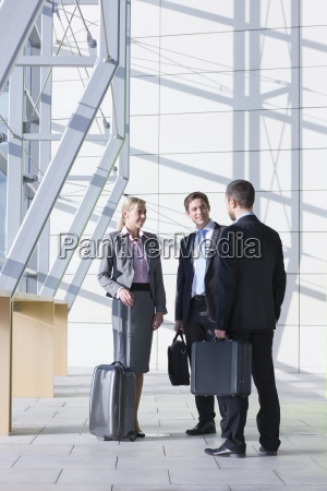 business people with briefcases and suitcase