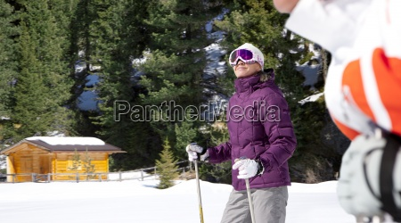 smiling woman wearing ski goggles and