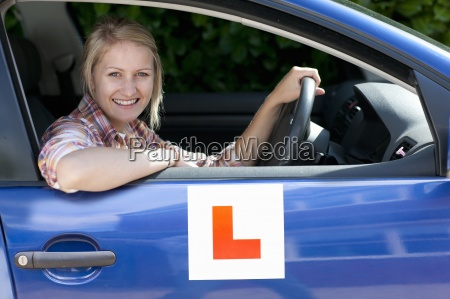 portrait of smiling young woman driving