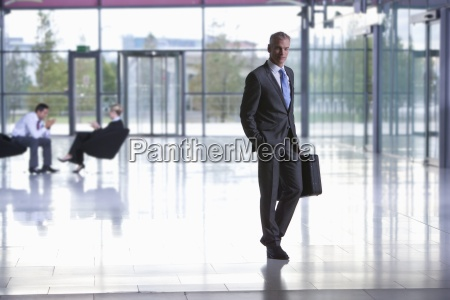 portrait of businessman with briefcase in
