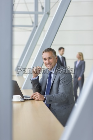 portrait of smiling businessman in suit