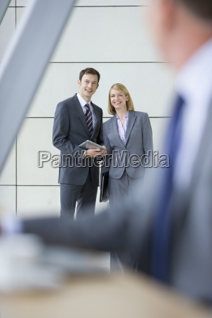 portrait of smiling business people with