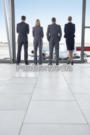 business people in suits standing at