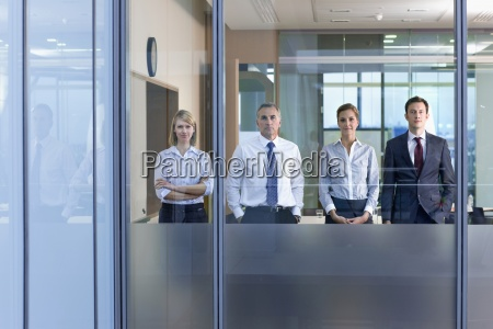 portrait of confident business people standing