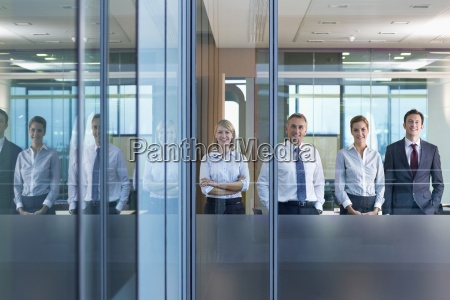 portrait of smiling business people standing