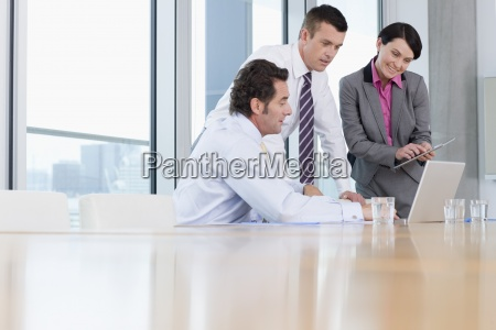 business people using laptop and digital