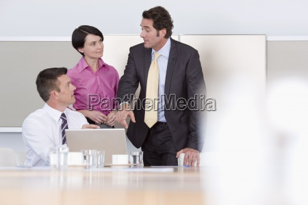 business people using laptop in conference