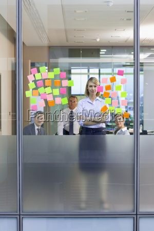 portrait of business people looking at