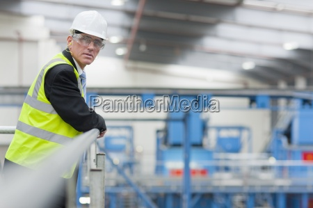 portrait of serious businessman standing at