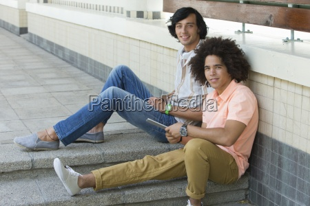 portrait of smiling young men using