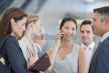 smiling business people talking