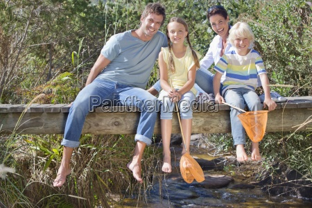 portrait of smiling family with fishing