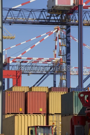 crane and cargo containers at commercial
