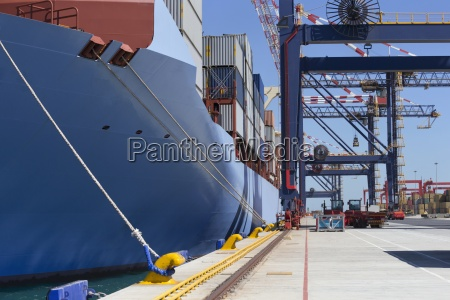 container ship with cargo containers moored
