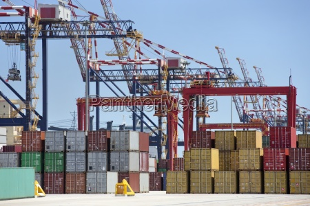 cranes and cargo containers at commercial