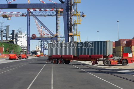 truck moving cargo containers at commercial