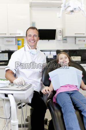 a male dentist with a young