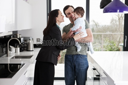 a working mother greeting her partner