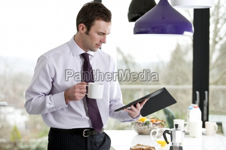 a businessman standing in a kitchen