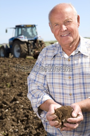 close up of smiling farmer cupping