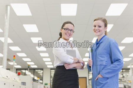 portrait of smiling engineer and businesswoman
