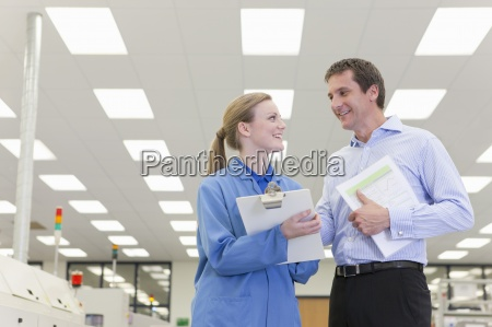 smiling engineer and businessman talking in