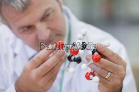 close up of chemical engineer examining