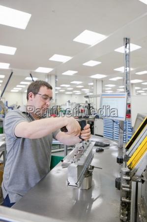technician assembling product in hi tech