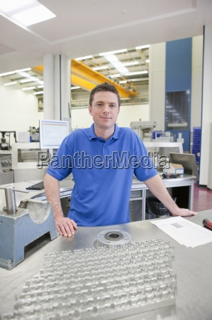 portrait of smiling technician with aluminum