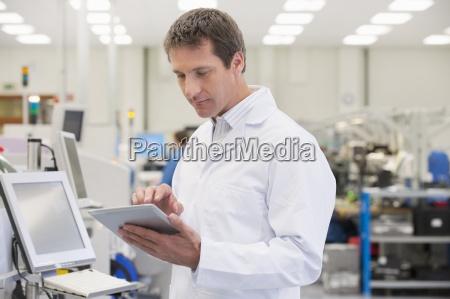 engineer using digital tablet in manufacturing